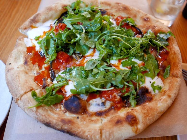 Burrata pizza, eggplant, tomato confit, basil, calabrian chili honey
