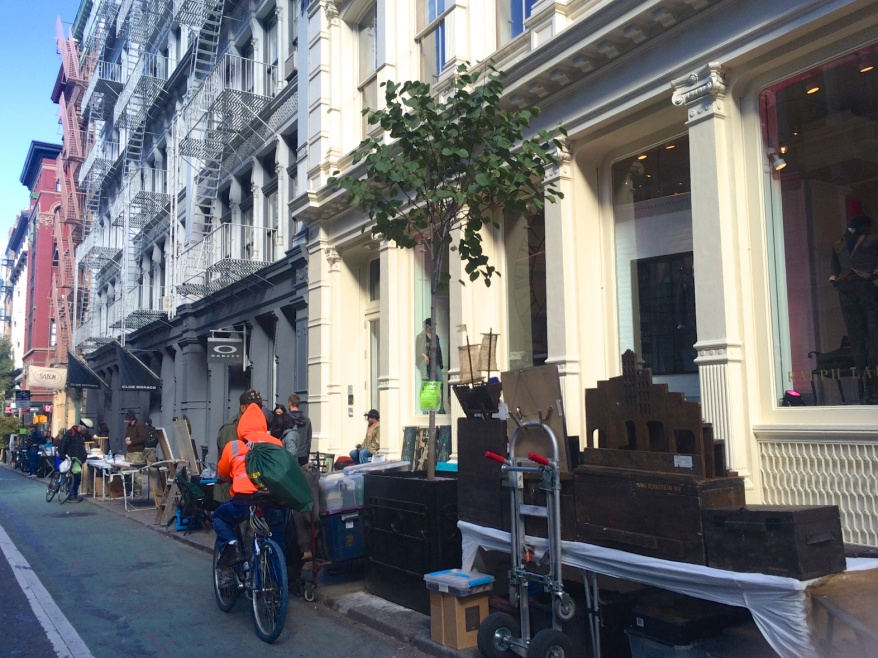 Vendors in Soho setting up their tables