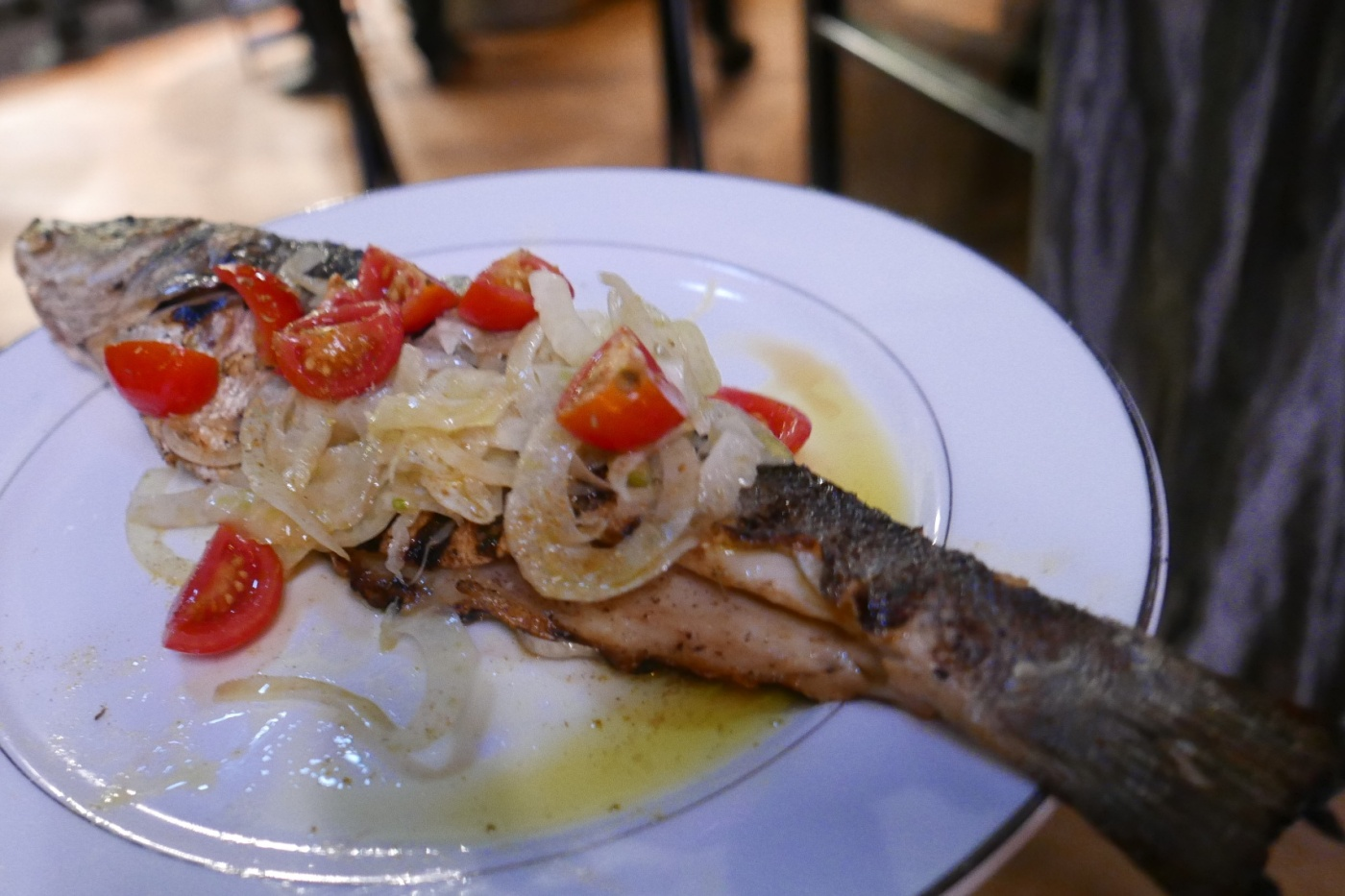 Grilled Whole Branzino, fennel pollen, olive oil, tomato confit