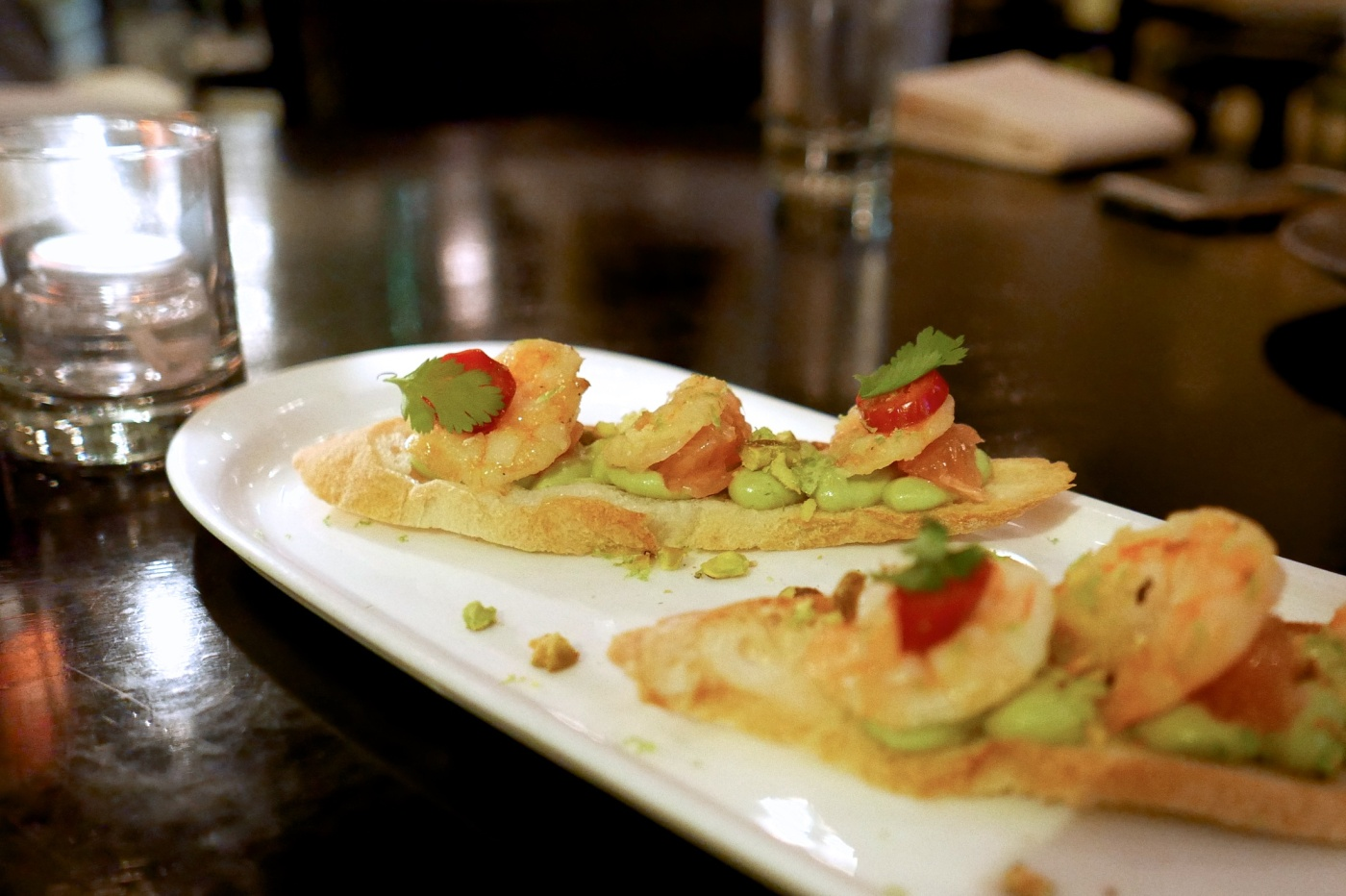 Shrimp Bruschetta, avocado, toasted pistachio, grapefruit, cilantro ($11)