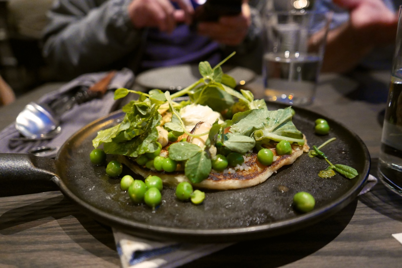 Sourdough Pancake, peas pea shoots, marinated mussels