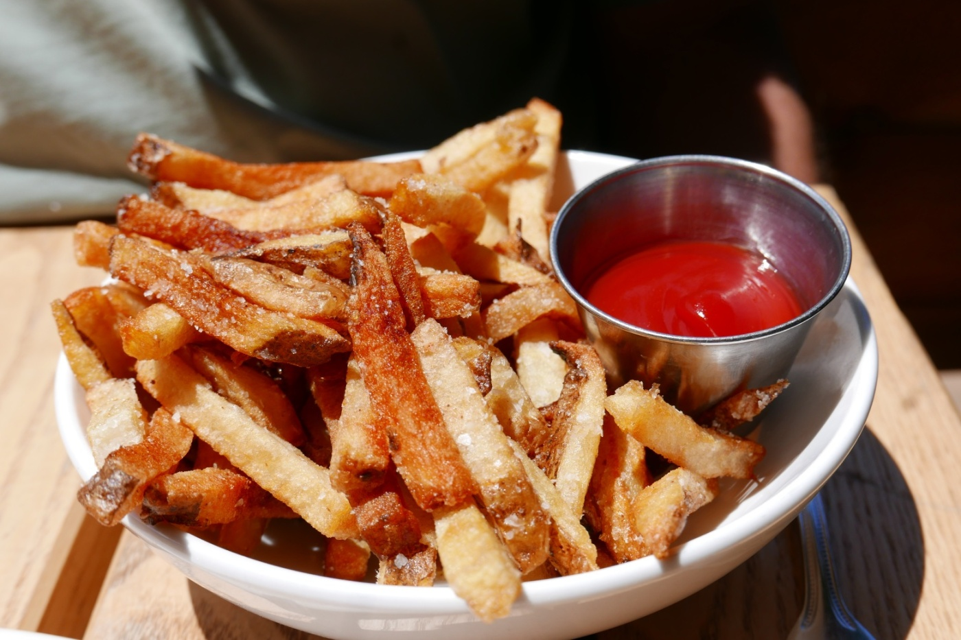 Beef fat frites, harissa ketchup, Perfectly crisp and flavorful.