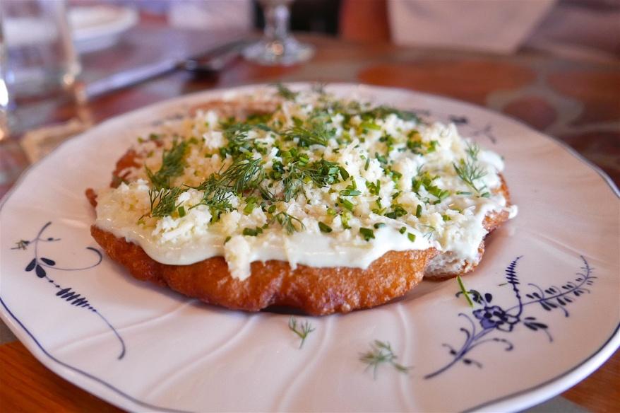 Hungarian Langos, fried potato bread, chive sour cream, gouda