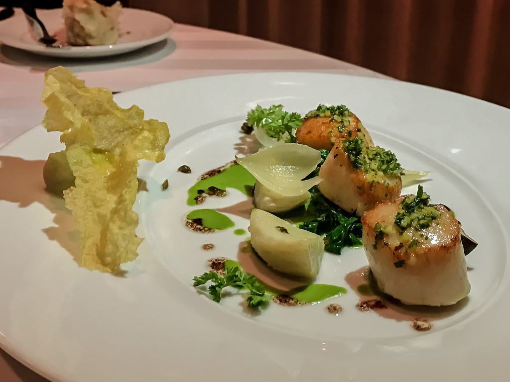 Roasted Scallop, maché purée, spruce, onion, artichoke, capers
