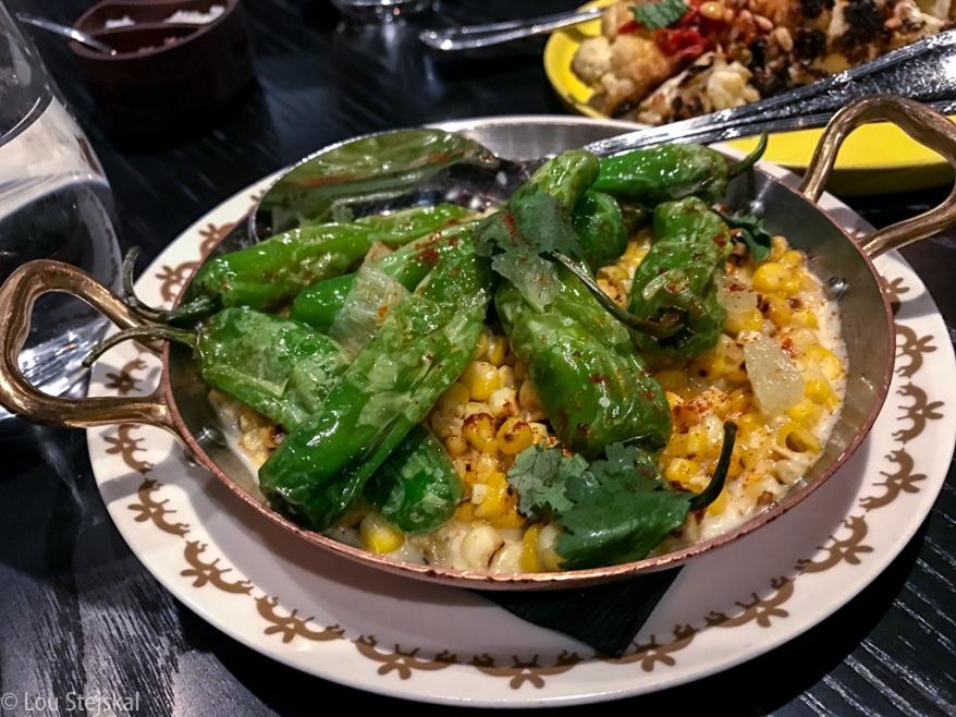 Shisito & Corn. Parmesan sauce, lime, paprika ($14)