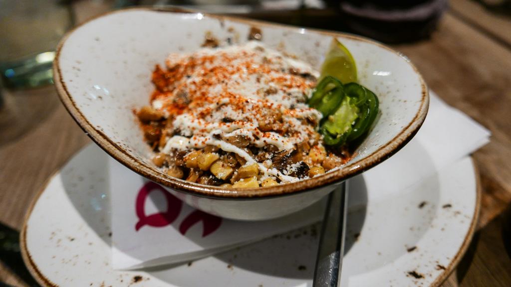 Esquite, grilled corn, chile, lime, queso, crema ($9)